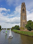 Boston Stump - St Botolph's Church with a few boats sailing in the river