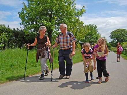 A family walking through the Lincolnshire countryside