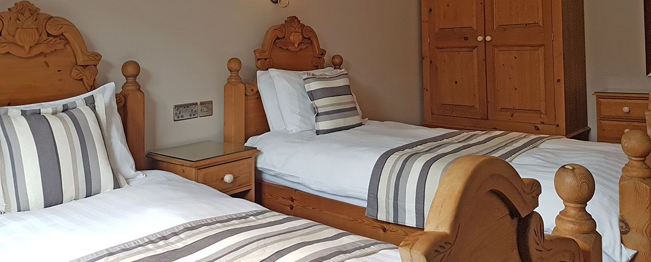 The family twin bedroom suitable for groups and cottage holidays