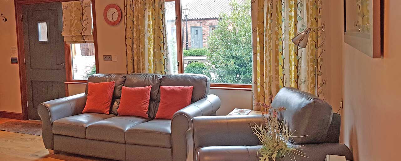 Leather sofa and chairs in our family country cottage lounge